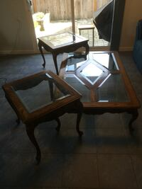 Beautiful hand stained coffee table and end tables. Paid $1200 new. Wonderful condition. Glass is beveled. Eugene, 97401