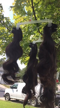 two black and one brown hair extensions Harrisburg, 28075
