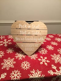 heart-shape brown wooden board with text wedding decor