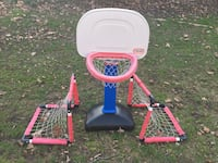toddler's red and white Little Tikes basketball hoop