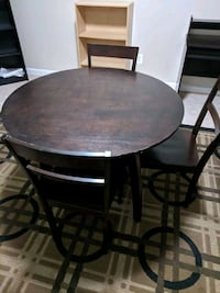 round brown wooden table with three chairs  Leesburg, 20175