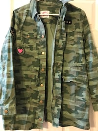Women's Justice camouflage jacket size 16/18 like new condition