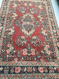 Red, blue, and white floral area rug