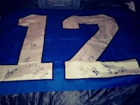 12th man flag with team signatures Seattle