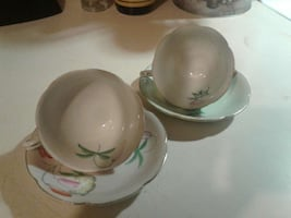 white green ceramic bowl and plates