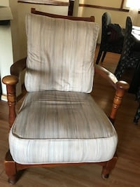 brown wooden framed white padded glider chair