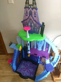 blue, purple, green, and pink 3-storey dollhouse 922 mi