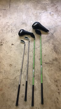 two black and green golf clubs Manassas, 20110