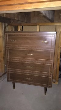 brown four drawer chest