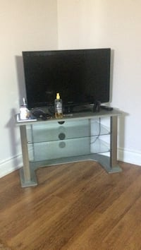 black wooden TV stand with flat screen television Toronto, M9N 1N3