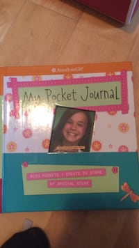 "New brand new American girl journal.  ""Make a one of a kind book about a one of a kind girl like you."" Includes stickers and more. My daughter never used it. It's just lovely! Check out my other new AG items! Laval, H7Y 2C1"