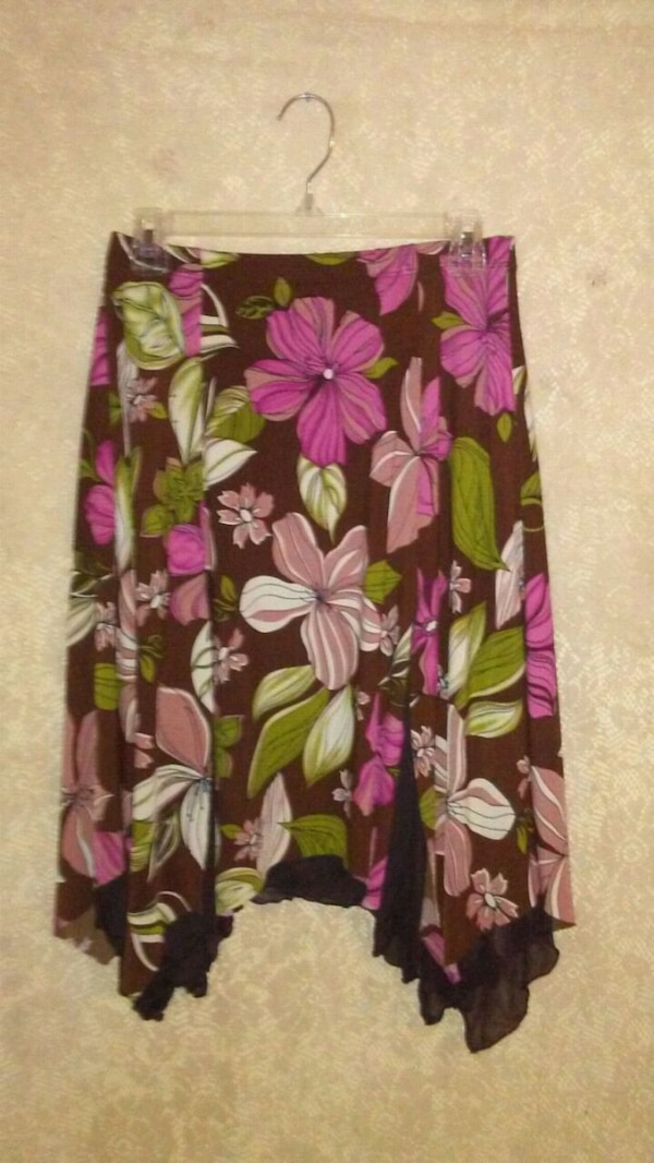 black, pink, and green floral skirt