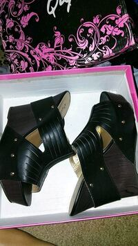 pair of black leather chunky heeled booties Fresno, 93728