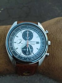 round silver and black Seiko chronograph watch with brown leather strap