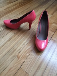 pair of pink leather kitten heeled shoes