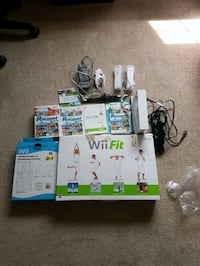 Wii consol with Wii fit and extra games. Langley