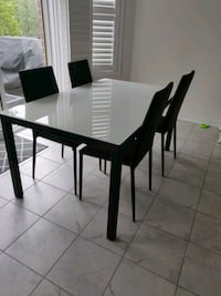 Beautiful glass top table and 4 leather chairs Halton Hills