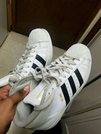 pair of white-and-black Adidas Superstar