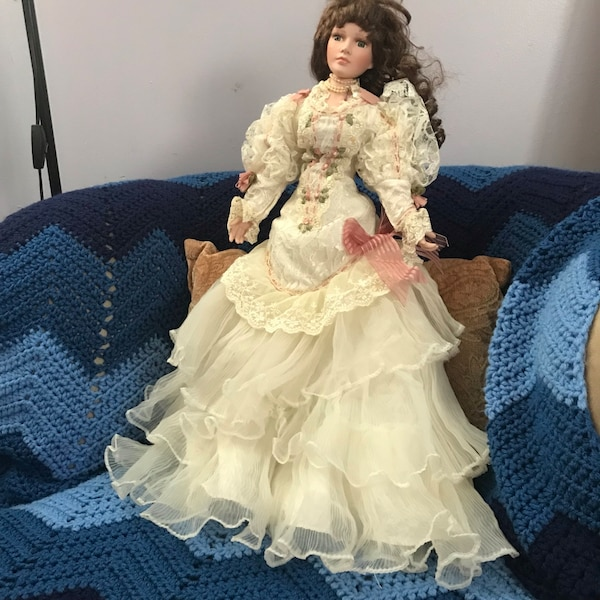 Porcelain doll in white dress