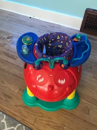 Baby bouncer with toys. Pick up today only