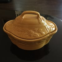 Yellow ceramic pot with lid