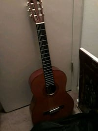 brown and black classical guitar. Case included Sanford, 32773