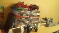 black Sony PS2 console with controller and game cases Schertz, 78154