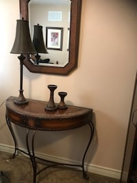 Brown wooden half-moon console table, mirror,lamp and candle holders table is a bit scratched up Hamilton, L8J 0A3