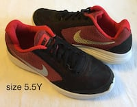 pair of red-and-black Nike running shoes