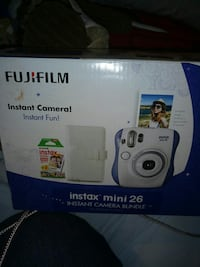 Brand new in box comes with film and album