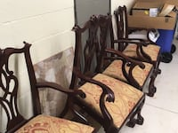 Brown wooden frame with brown padded armchair