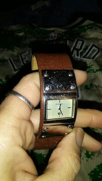 square silver analog watch with brown leather strap