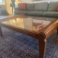Large wood coffee table with glass top