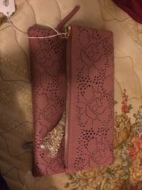 Pink Carian Perforated Clutch Lubbock, 79404