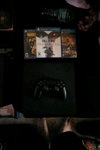 black Sony PS4 console with controller and game ca Grafton, 26354