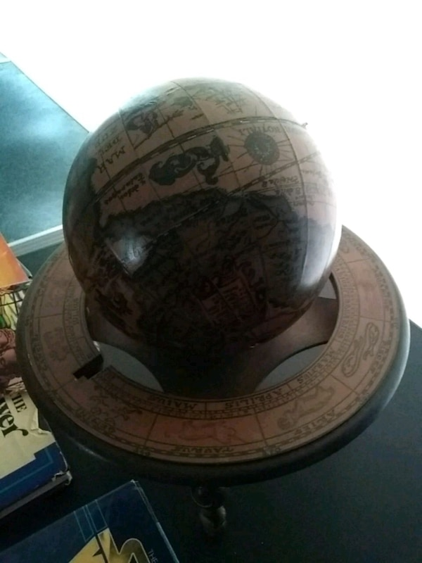 brown and green desk globe