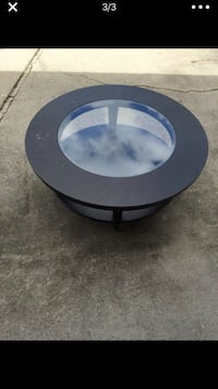 Round black solid wood and glass coffee table
