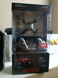 black and red quadcopter drone with box Ottawa, K1T 3S5