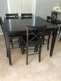 Rectangular black wooden table with four chairs dining set Temecula, 92592