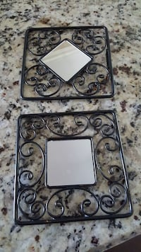 2 black decorative mirrors