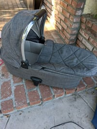 Mamas & Papas baby carrier. Hooks up to some mamas & papas stroller