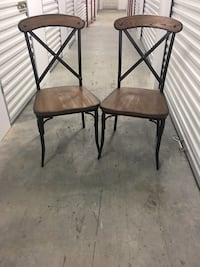 two brown wooden chairs with black steel frames Alexandria, 22303