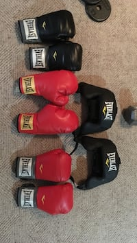 Offers on boxing gloves , red 14oz pair 40$ OBO , other red pair 20$ OBO, black 12 oz (6/10 condition) 25$ OBO, both head gear 40$ each . Will take all together for 150 or sell separate