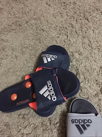 black-and-red Adidas slide sandals 26 mi