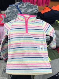 white, pink, and blue striped polo shirt null