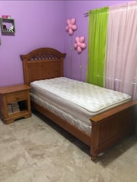 Brown wooden bed frame with white mattress Hialeah, 33014
