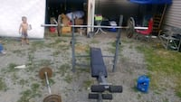 weight bench with weights and curling bar. Spokane, 99202