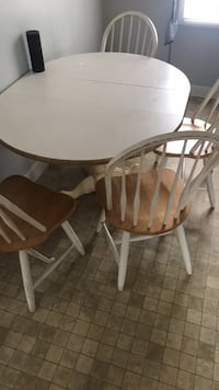 round brown wooden table with four chairs dining set Myrtle Beach
