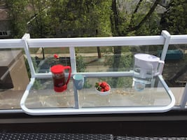 Glass folding railing table, perfect for small spaces.