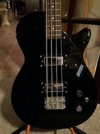 Gretsch bass guitar, with stand, and with bass amp